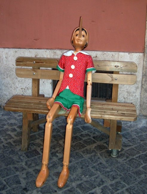 Puppet Tut sits on a throne of wooden lies!