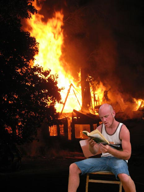 guy reading in fire
